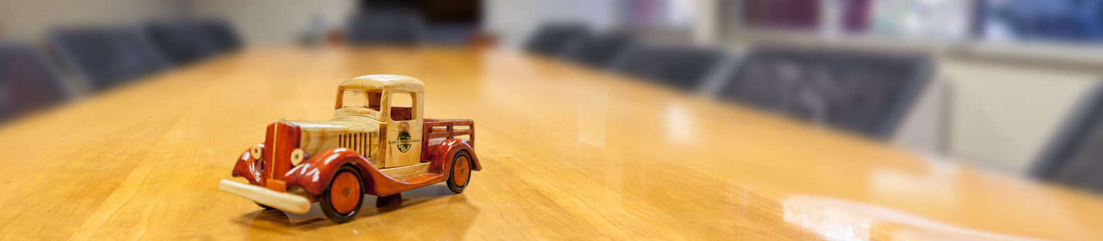 Small toy car on a desk.