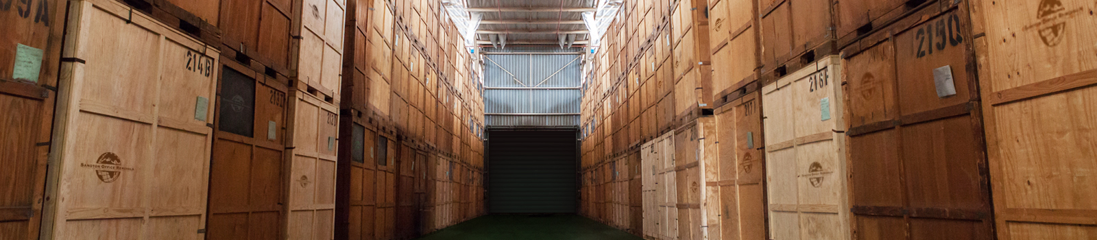Boxes and crates stored in a warehouse.